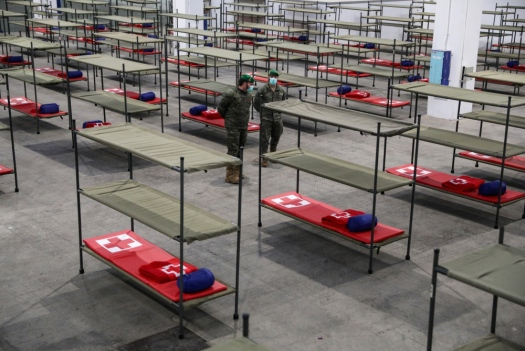 Members of the Logistics Brigade of the Spanish Army are pictured next to bunk beds for homeless people at a shelter in the Fira Pavilion, as the coronavirus disease (COVID-19) outbreak continues, in Barcelona